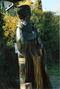Statue of St. Naum at the entrance to his church on the shore of Lake Ohrid