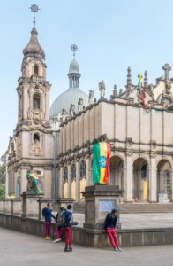 Addis Ababa, Ethiopia - January 14 , 2016: Joung local people in front of the Cathedral of the Holy Trinity