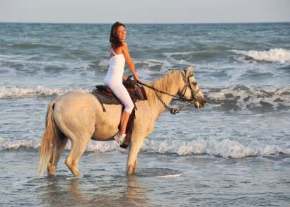 Riding a horse in the surf