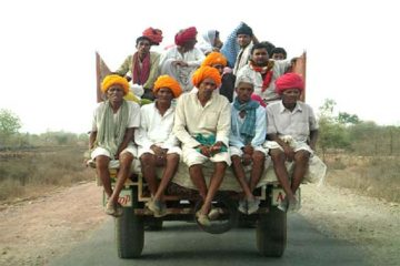 Riding on the back of a truck in India