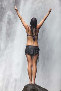Woman Standing at a Waterfull